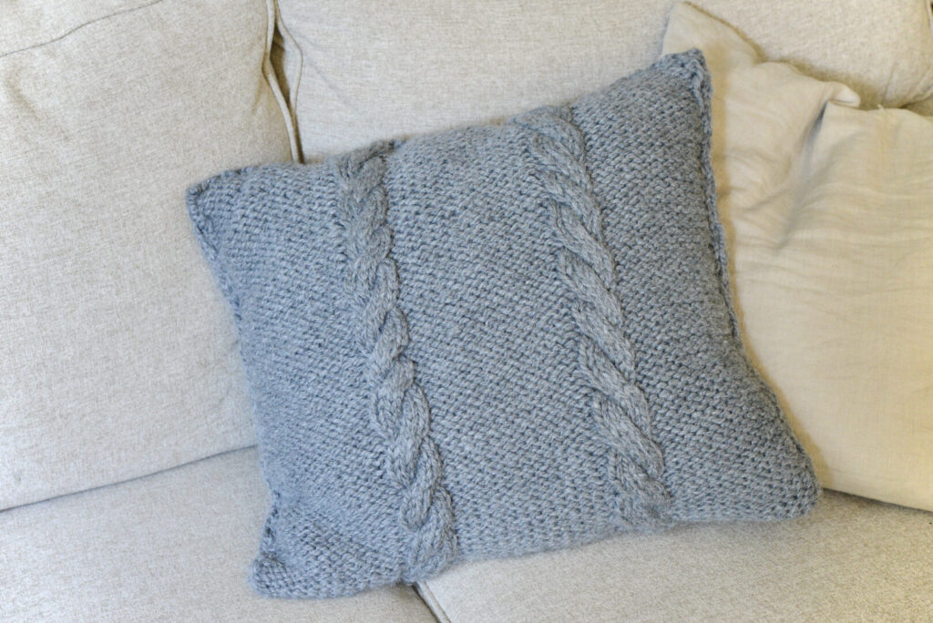 knit pillow with cable pattern