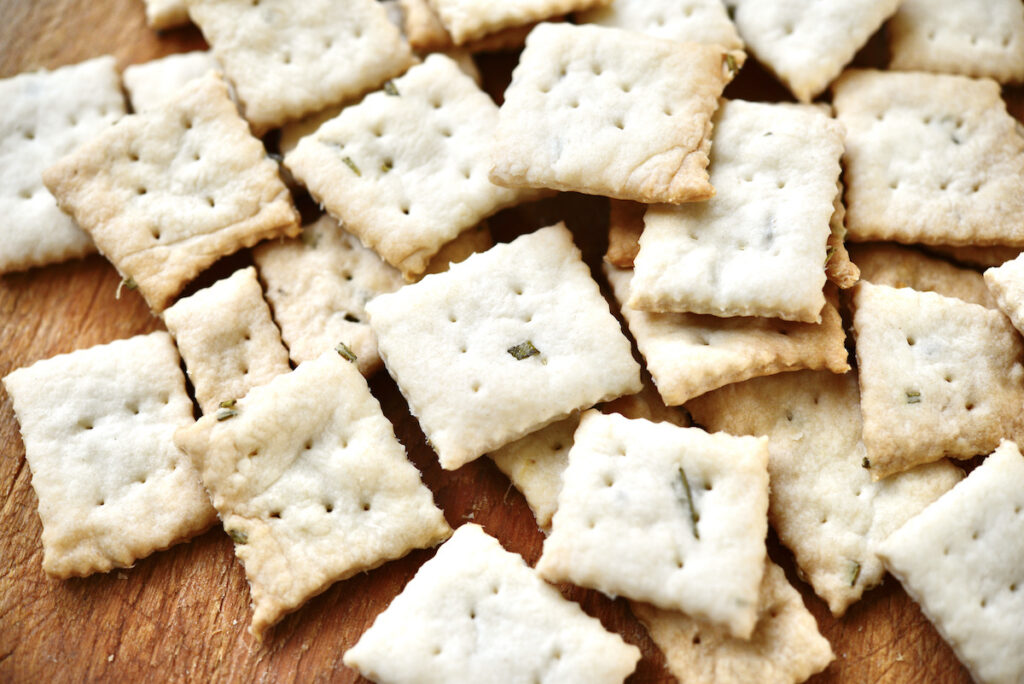 crackers on wooden cutting board